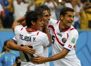 Costa Rica's Bryan Ruiz celebrates his goal with team mates Yeltsin Tejeda and Celso Borges during their 2014 World Cup round of 16 game against Greece at the Pernambuco arena in Recife