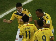 Colombia's Rodriguez celebrates with his teammates after scoring a goal against Uruguay during their 2014 World Cup round of 16 game at the Maracana stadium in Rio de Janeiro