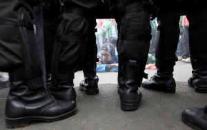 Police block student demonstrators during a protest outside the parliament in Jakarta
