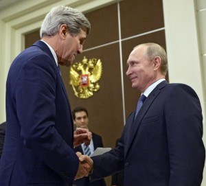 U.S. Secretary of State John Kerry, left, shakes hands with Russian President Vladimir Putin at the Bocharov Ruchei residence in Sochi, Russia, Tuesday May 12, 2015. (Alexei Nikolsky/RIA-Novosti, Kremlin Pool Photo via AP)