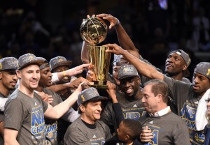 The Golden State Warriors celebrate with the Larry O'Brien Trophy. Mandatory Credit: Bob Donnan-USA TODAY Sports