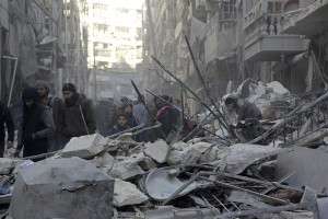 Residents inspect damage after airstrikes by pro-Syrian government forces in the rebel held Al-Shaar neighborhood of Aleppo, Syria February 4, 2016. REUTERS/Abdalrhman Ismail