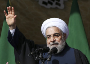 Iranian President Hassan Rouhani waves to the crowd at the conclusion of his speech during a rally to commemorate the 37th anniversary of the Islamic revolution, at the Azadi (Freedom) Sq. in Tehran, Iran, Thursday, Feb. 11, 2016. The nationwide rallies commemorate Feb. 11, 1979, when followers of Ayatollah Khomeini ousted U.S.-backed Shah Mohammad Reza Pahlavi. (AP Photo/Vahid Salemi)