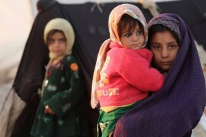epa05042194 Afghan children displaced from Faryab, Badghis and Ghor province, stand outside a temporary shelter at an Internally Displaced Persons (IDPs) camp in Herat, Afghanistan, 26 November 2015. According to UN Refugee Agency (UNHCR) figures, the number of internally displaced Afghani people was 683,000 by mid-2014, estimating they will amount to 900,000 by the end of 2015. EPA/JALIL REZAYEE