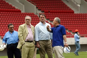 epa000205026 President of Olympiakos Piraeus soccer team, Sokratis Kokkalis (2nd L) and coach Dusan Bajevic ( C) visit Karaiskaki soccer stadium , near Piraeus, Greece, Friday 04 June 2004. Karaiskaki soccer stadium will host a total of 11 games (preliminaries, quarter-finals and semi-finals) of the Olympic Football Tournament as well as both men's and women's finals. After the games will be delivered to Olympiakos Piraeus. EPA/LOUISA GOULIAMAKI